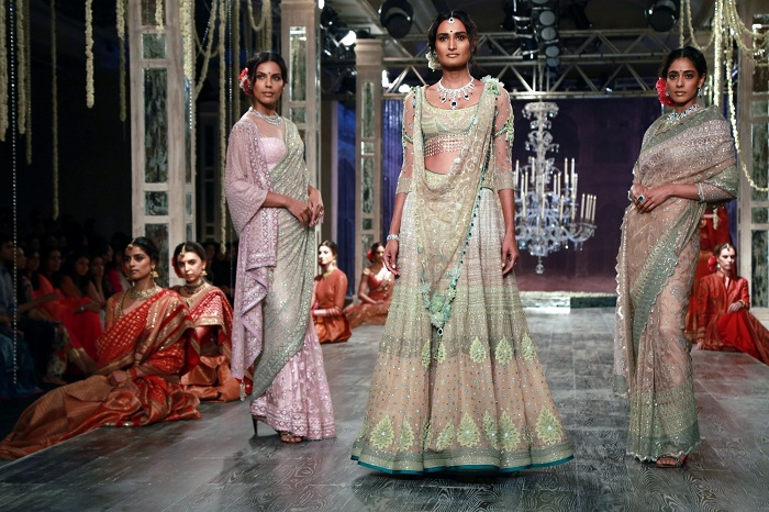 New Delhi: Models walk the ramp displaying an outfit by fashion designer Tarun Tahiliani during the India Couture Week 2016, in New Delhi on July 21, 2016. (Photo: Amlan Paliwal/IANS)