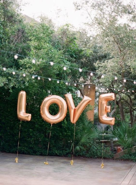 love giant letter balloons for wedding reception decor